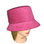 Handmade hat by Pip 'n' Milly Creations, made in raspberry pink corduroy with black and pink cotton lining
