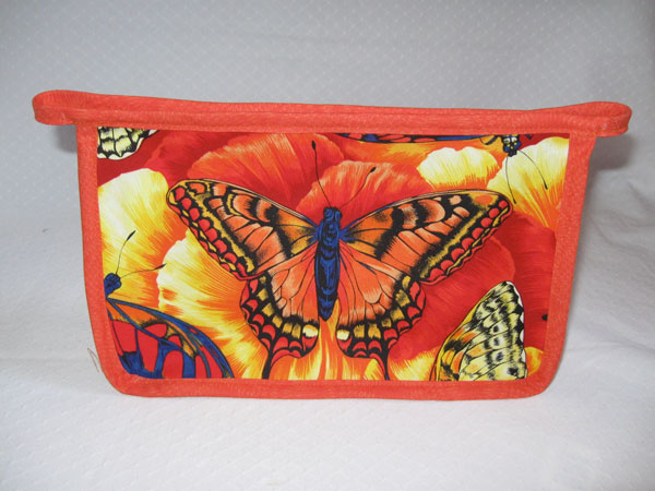 zippered WIP pouch in orange butterfly print