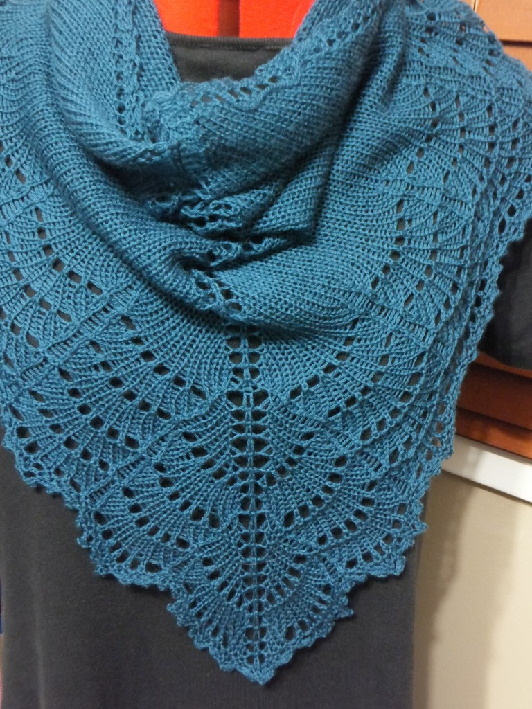 Lacy shawl in teal laceweight yarn