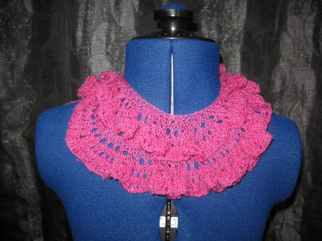 Knitted pink lacy, ruffled scarf with beaded cast off