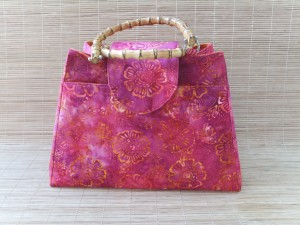 Pink and orange batik fabric used for custom order knitting bag with bamboo handles