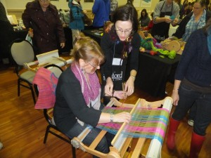 Me with Elizabeth Ashford, weaving on a Knitter's Loom